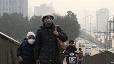 Asian Cities Choking on Worsening Air Pollution !!!  A woman and a child wearing masks walk hands in hands as a cyclist covers his nose for protection against the pollution on a pedestrian overhead bridge on a polluted day in Beijing, Sunday, Dec. 20, 2015.