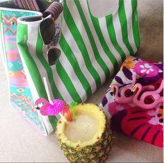 poolside relaxin with a fresh piña colada, flamingos galore, and a Consuela tote