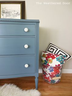 A smokey blue dresser with white knobs | The Weathered Door #furnituremakeover