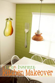 Such a happy and fun Citrus Inspired Kitchen Makeover! I like the green wall.