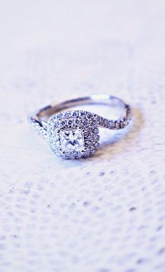 OMG! This is perfect! Love the swirl that makes it unique!           White Gold Contemporary Halo Engagement Ring