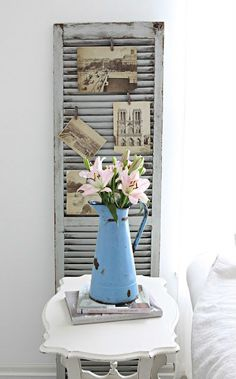 pictures clothespinned on shutters