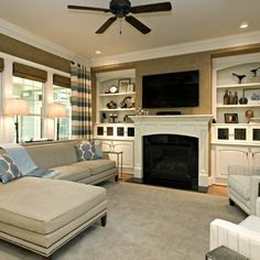 tv above electric fireplace with bookshelves | Raleigh Home tv above fireplace Design Ideas, Pictures, Remodel and ...