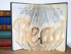 folded book art with the word Read by prettythingsbyQ on Etsy
