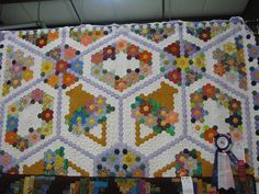 This is the English paper piecing that I do with all the tiny hexagons ...