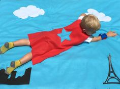$50 - This Super Hero photobooth backdrop is created to lay on the ground so your super heros appear to be flying through the sky. The backdrop is approximately 55 inches by 65 inches, and comes with 8 photobooth props including - 2 clouds - 3 skyline pieces - 1 Statue of Liberty - 1 Eiffel Tower - 1 Leaning Tower of Pisa  The photo booth props ARE NOT ATTACHED, so each super hero can arrange a new custom theme just for their photo!