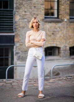 Lisa Hahnbueck wearing Samsoe Samsoe knit white Redone jeans Chanel slippers white Chanel bag seen during the Copenhagen Fashion Week Spring/Summer...