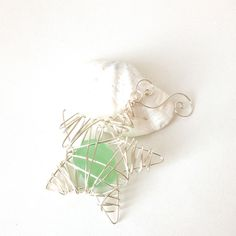 sea foam sea glass star ornament. $26.00, via Etsy.