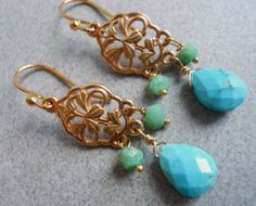 """Rare Sleeping Beauty Turquoise dangles from a gold vermeil chandelier. The green stones are chrysoprase. The total length is about 1 5/8"""". 14K gold plated earwires are shown. If you would like to upgrade to leverbacks for $12 upcharge, please click that box. Your earrings will arrive beautifully giftwrapped."""