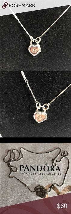 Pandora lock your promise Necklace NWOT This Stylish Pandora Necklace in Sterling Silver with the Heart shaped focal point pandora logo and Pink Zirconia Stones , chain length s 60 cm .Please check all pics and make Zoom for Full Details Retail Price is $100 + Tax pandora Jewelry Necklaces