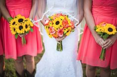 Sunflowers with coral from rusticweddingchic.com