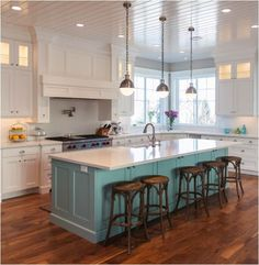 counter height island with sink, love the blue under cabinet & stove. Mahogany blue-stained DeWils soft-closing cabinets is my preference.