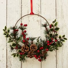 35 Fabulous Winter Wreaths Design Ideas Best For Your Front Door Decor - When most of us think of front door wreaths we think circle, evergreen and Christmas. Wreaths come in all types of materials and shapes. Christmas Pine Cones, Christmas Rose, All Things Christmas, Rustic Christmas, Ideas Decoracion Navidad, Xmas Wreaths, Winter Wreaths, Door Wreaths, Rustic Wreaths