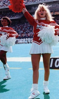 The Evolution of Cheerleading Uniforms - - Cheerleading uniforms have dramatically been reinvented to reflect the changes in American culture, fashion trends, and the athleticism required. Cheerleading Pictures, Cheerleading Uniforms, Cheerleading Workouts, Black Cheerleaders, Cheerleading Cheers, School Cheerleading, High School Cheer, School Sports, Cheerleader Costume