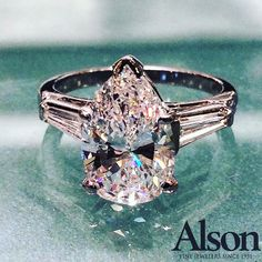 3.38 carat Pear-shaped diamond engagement ring accented with baguettes.