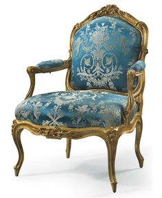 A LOUIS XV GILTWOOD FAUTEUIL A LA REINE BY JEAN-JACQUES POTHIER, MID-18TH CENTURY With a cartouche-shaped upholstered backrest carved with ribbon-tied laurel leaves at the cresting, with padded armrests on raised volute supports, the serpentine seatrail similarly carved, on carved cabriole legs headed by bellflowers, stamped twice I. POTHIER and inscribed XXII, the drop-in seat inscribed twice XXI