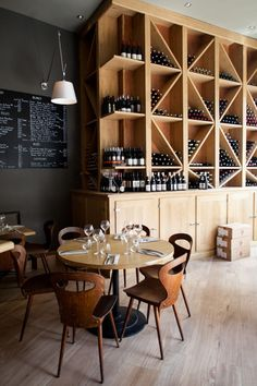 Dense walls contrast with the lighter wood wine rack, Pirouette, Paris.