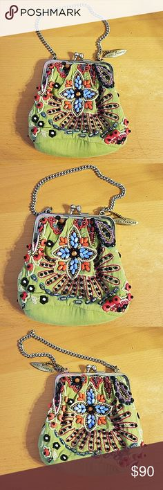 "Mary Frances beaded purse Mary Frances beaded purse green purse with colorful handmade beading. Never used. Approximage measurements are Across middle bottom 5""×2""  Clasp to bottom 5"" Mary Frances Bags"