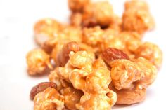 This is the Cowgirls' buttercrunch popcorn that started it all. Our special hybrid corn is popped fresh to order, tossed with toasted nuts, then drenched in the most beautiful, buttery caramel you have ever tasted. This is popcorn perfection.