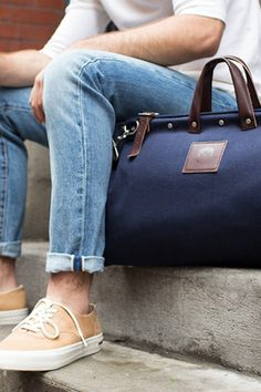 12 Best Men's Weekend Bags - We hate to break it to you, guys, but when it comes to traveling in style, your gym bag/college-era duffel isn't going to cut it. What will? These 12 sophisticated weekend bags. Sturdy, spacious, and hella handsome, they'll instantly elevate all your airport looks. Read on.