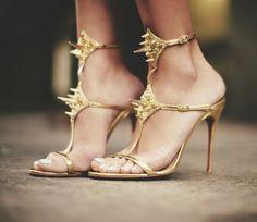 gold spike heels / Christian Louboutin