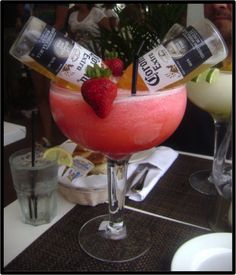 Bulldog Margarita: 2 Coronas, 2 Cups of Strawberries, 1/2 Cup of Tequilla,1/4 Cup Triple Sec,2 Cups of Crushed Ice... In a blender combine all ingredients except the beers. Blend until smooth and serve in a large cocktail glass or fishbowl. Place two beers upside down into the cocktail and garnish with a few extra starwberries.