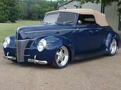 Gorgeous 1940 Ford. convertible, mine has blue mercedes cloth top