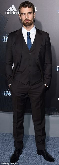 Leading men: Theo and Ansel went for classic suits to the premiere of the Divergent saga's...