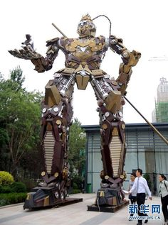 "This metal statue may look something out of the Hollywood film ""Transformers,"" except that it also includes elements of the Monkey King, lead character from the classic Chinese novel Journey to the West. The 11-meter-tall statue stands on a street in northeast China's Shenyang city and weighs 10 tons. And to make it more interesting, the statue has been assembled from discarded auto parts."