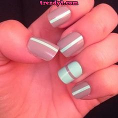 Nude & blue nails with a vertical stripe per nail- ring finger is horizontal with flipped colour scheme