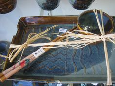 Textures:a combined effort of area artisansa.k.a. Textures Craftworks  -ceramic sushi set by Diane Irons - $34
