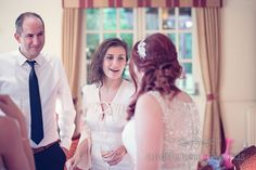 Bride greets guest at Bournemouth Hotel Wedding. Photography by one thousand words wedding photographers