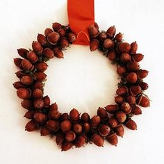 Acorn ring wreath...  Combine moss and acorns to create a simple but lovely fall wreath. Hot-glue moss to a small wire or cardboard ring, then glue acorns to the ring. If needed, secure the acorns to their caps with glue. Hang with a satin ribbon.