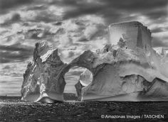 """An iceberg photographed on the Antarctic Peninsula. Note the """"castle tower,"""" at top right, apparently carved in the ice by wind erosion. (2005.)"""