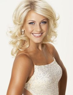 Medium to long layers are cut all through the back and sides to balance out the body and volume of the curls...