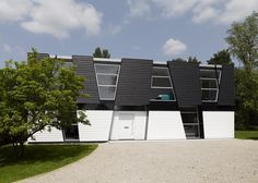 Front View3 Daring Geometry - Black And White House in Kent Sliced Up Into Irregular Shapes