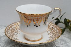 Paragon White and Gold Tea Cup and Saucer