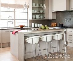 Extra cupboards under the overhang of this kitchen island are a clever spot to store less-used items and keep counters clutter-free. Smart Kitchen, Compact Kitchen, New Kitchen, Kitchen Dining, Kitchen Decor, Dining Rooms, Kitchen Ideas, Kitchen Island Storage, Kitchen Islands