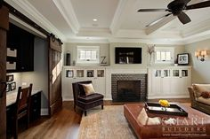 Contemporary Craftsman Style Custom Home • Family Room • Sliding Barn Doors • Fireplace • Computer Desk • Hardwood Floors • SMART Builders, Inc.