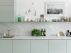 Last month I saw this kitchen in the Elle deco UK and it blew me away ... I like everything about it. But the mint green color is just superb. I am sure I wouldn't dare do this but now...