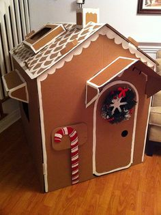 This life-size gingerbread house was assembled from several large pieces of cardboard and features a working door. Cardboard was chosen for a material because of its durability and ease of gluing decorations onto it. In addition, it has the same color as gingerbread.
