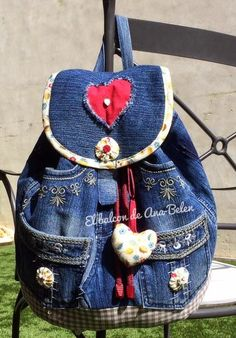 a backpack made of old jeans and decorated with yo-yos and hearts