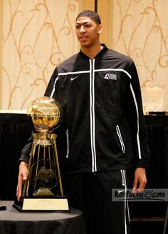 Photo Gallery: Anthony Davis accepts the Associated Press Player of the Year trophy
