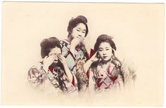 "This old postcard features three Japanese girls in elaborate kimonos doing a version of the three wise monkeys -- also known as ""see no evil, hear no evil, speak no evil."""