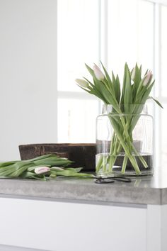 Tulips are inexpensive and perfect flowers for at home arranging. The less done to them the better!