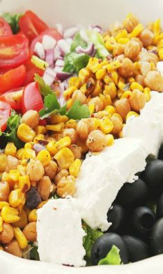 Roasted:-450 F 10-12 mins.: 3 tablespoons olive oil 2 C corn kernels 1 can (16-oz) garbanzo beans, well rinsed kosher salt, to taste fresh ground pepper, to taste 3 sprigs of thyme, leaves only ½ tablespoon red pepper flakes Salad: 4 cups chopped romaine lettuce 2 tomatoes, thinly sliced 1 cup black pitted olives, quartered 1 red onion, diced 1 cup crumbled feta cheese Lemon Vinaigrette: ¼ cup fresh lemon juice, about 1 large lemon ¼ cup extra virgin olive oil salt and pepper, to taste