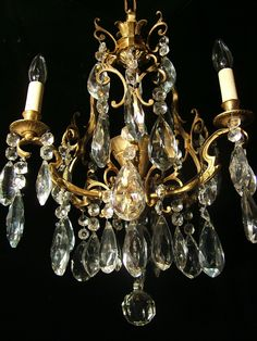 Petite French bronze 3 light chandelier made in Europe in the 1930s. $895.00, via Etsy.