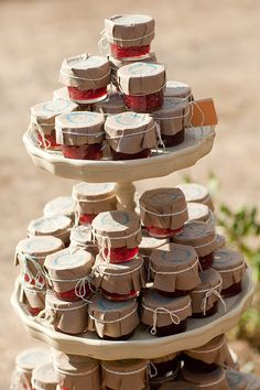 Jealin-We could cover the little jars like this too... Maybe spray paint would be easier...