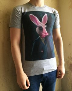 An alternative look at the White Rabbit but this time as a funky Men's DTG T-Shirt. Like the print this is based on the famous 'Alice in Wonderland' story by Lewis Carroll. I have tried to make him look more suave and dapper than the timid and feeble character described in the book. Also if you look closely at the background wallpaper you can see I have created a Tatton style 'Queen of Hearts' wallpaper for the Rabbit to stand against. Heart Wallpaper, Lewis Carroll, Queen Of Hearts, Alice In Wonderland, Dapper, Rabbit, Alternative, Book, T Shirt
