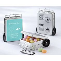 "Show your guests how much they mean to you for coming so far for your destination wedding... thank them for making the trip with these Suitcase Favor Tins. Amazing detail makes these tins extraordinary tiny wheels that roll, a handle that pulls up and down and retro travel stickers on one side. Hanging from the handle is a tag that says ""Thanks for Making the Trip!"" Fill the tins with wrapped chocolates, Mints, etc..."